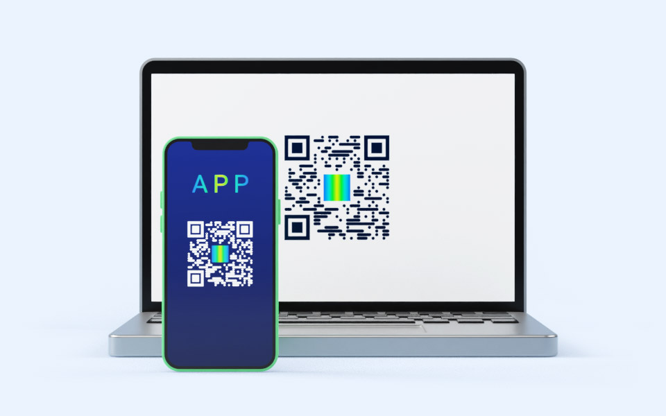 Laptop with WWPass QR-code and smartphone